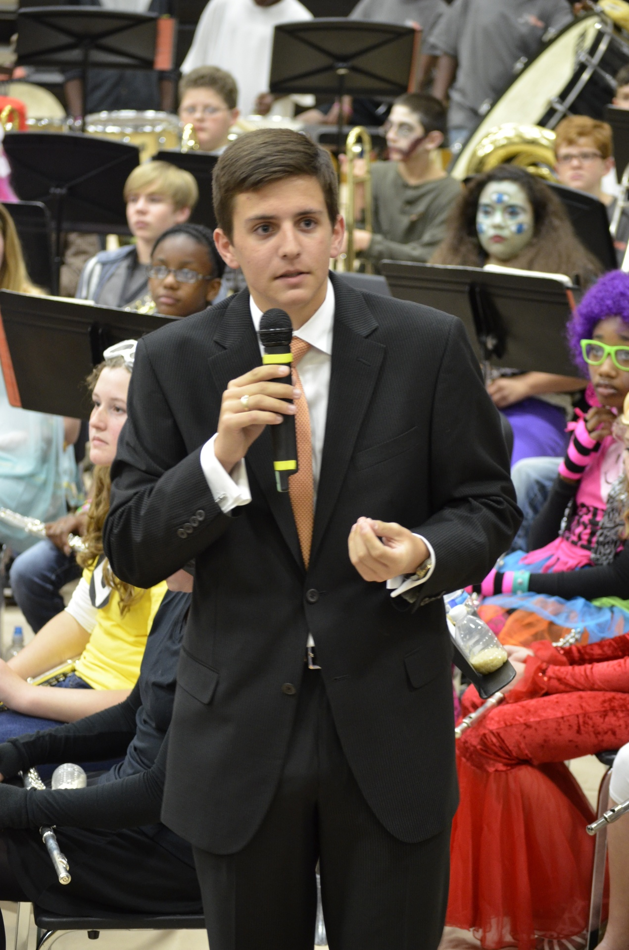 Grant, age 18, speaking at the Simmons Middle School (Hoover, AL) Band Halloween Costume Concert – 2013