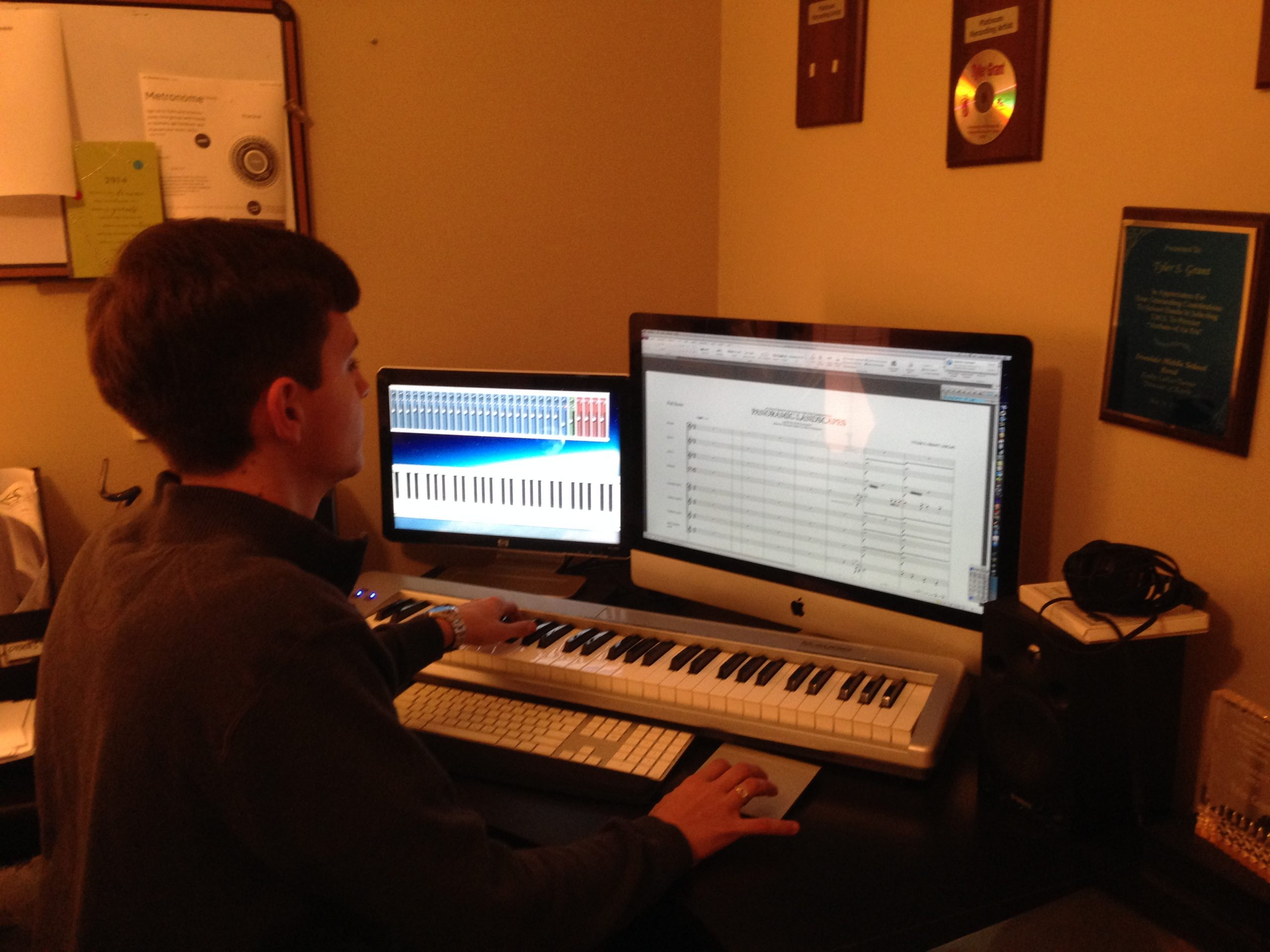 Grant, age 18, at work station.