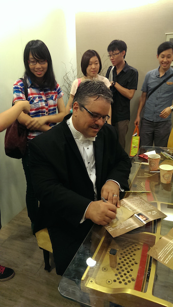 TOP: Signing autographs for fans after a performance in Taiwan RIGHT: Smith's classic composition
