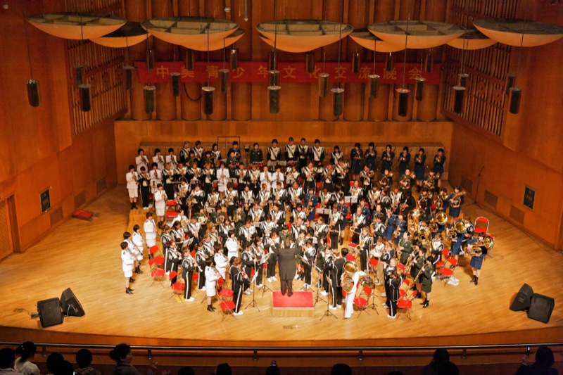 The combined bands of the North Monterey County High School Symphonic Band and the People's Liberation Army Band of China, playing our national march Stars and Stripes Forever, followed by the playing of the Chinese national march Motherland, at the China National Performing Arts Center in Shijiazhuang, China. The conductor is D.L. Johnson.