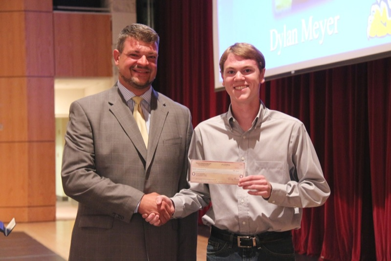Pete Biedron, Owner of the Band Source, Downers Grove, Ill presents scholarship check to Dylan Meyer, a 12th grade student at Neuqua Valley High School, Naperville, Il.