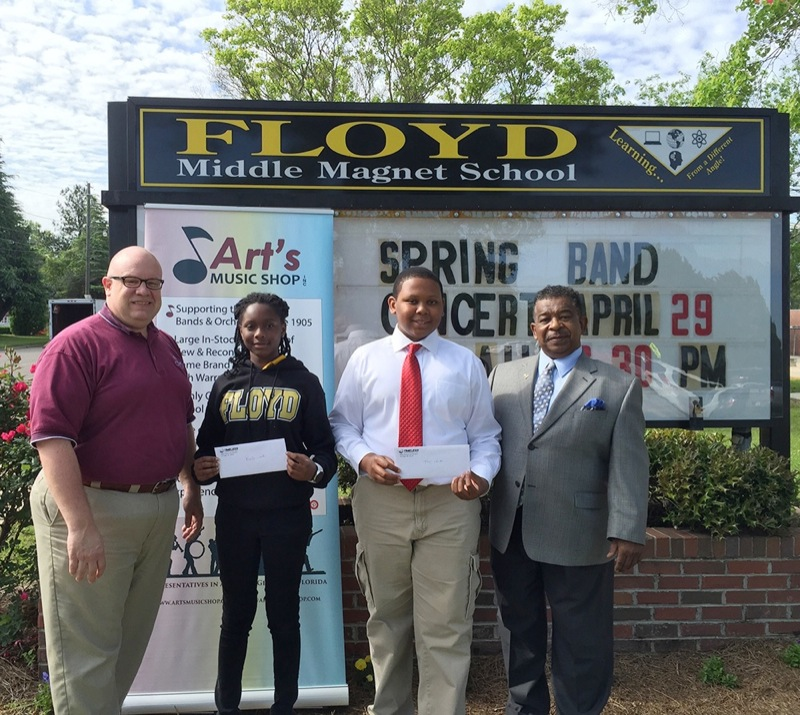 Floyd Middle Magnet School, Montgomery, Ala had two winners in the recent SBO Essay Scholarship Contest.  Matt King (left) Art's Music Store presented the checks to students Angeli'c Harris and Trey Bird along with their music director, Coleman Woodson.