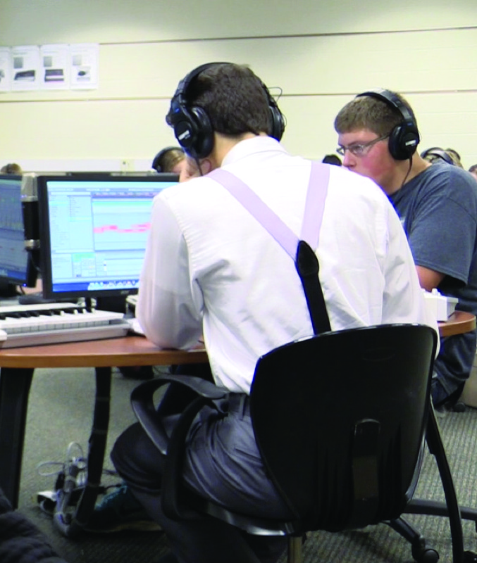 Student working in William's music tech program