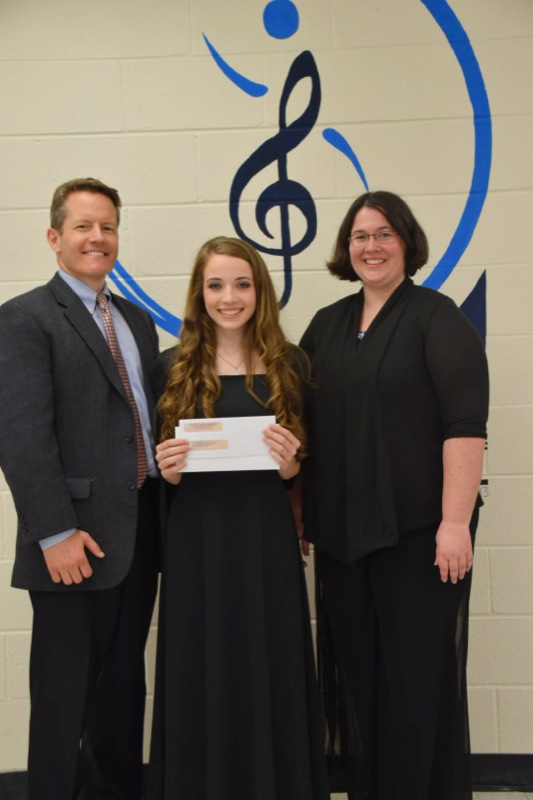 Joel Menchey, President of Menchey Music presents SBO Essay Contest check to 16 year old Caitlyn Stupi  and her music teacher Jennifer Jones, Westminster High School,  Westminster, MD.