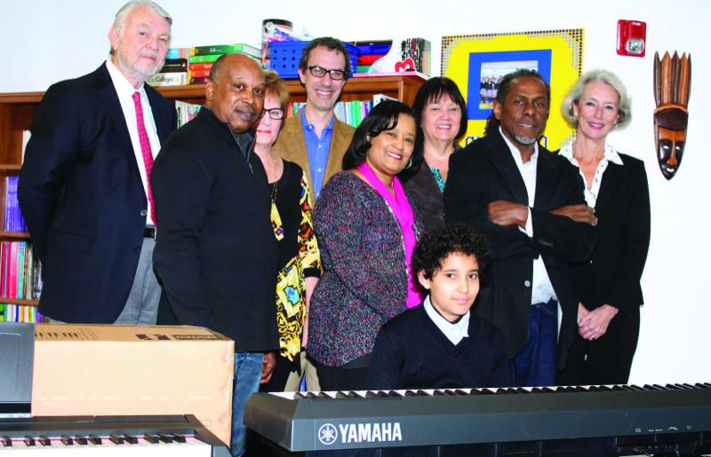 Left to right: Ken Albrecht, Johnny Harris, Judy Albrecht, Salah Boukadoum, Karen Harkey, Freddie Jones, and Lynn Nikaidoh. At the keyboard: Maphios Mekbeb-Gillette, student at Choice Leadership Academy.