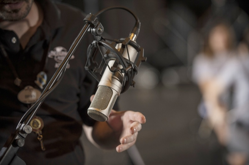 Universal Orlando's production team sets up high-quality microphones to capture the students' performance during the Sound Design: Music and the Art of Foley workshop.
