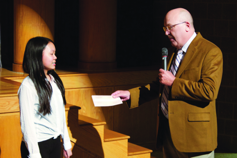 Claire Cao, 7th Grade Student at Tohickon Middle School, Doylestown, PA receives scholarship award from Jim Forester, Russo Music, Chalfont.Pa.