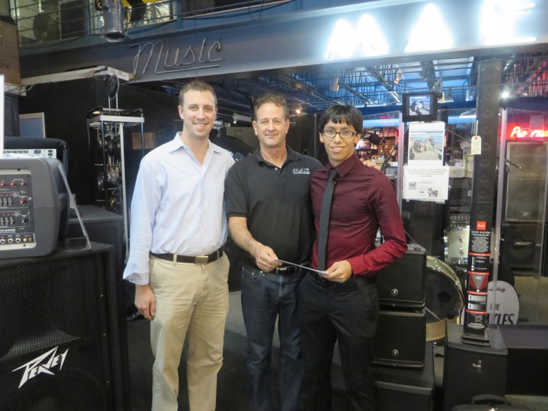 Ken Katz (center) Music Arts Enterprises presents scholarship to Jose Veliz, a grade 12 student at Cypress Bay High School, Weston, FL and his music director (right) Jonathan Jadvani.