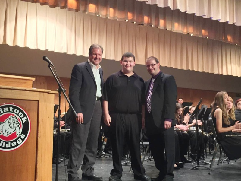 Ron Kuykendall, Saied Music, Tulsa, OK congratulates ninth grade student Tanner Robertson and his music director, Robert Newhart, Collinsville High School, Collinsville, Ok