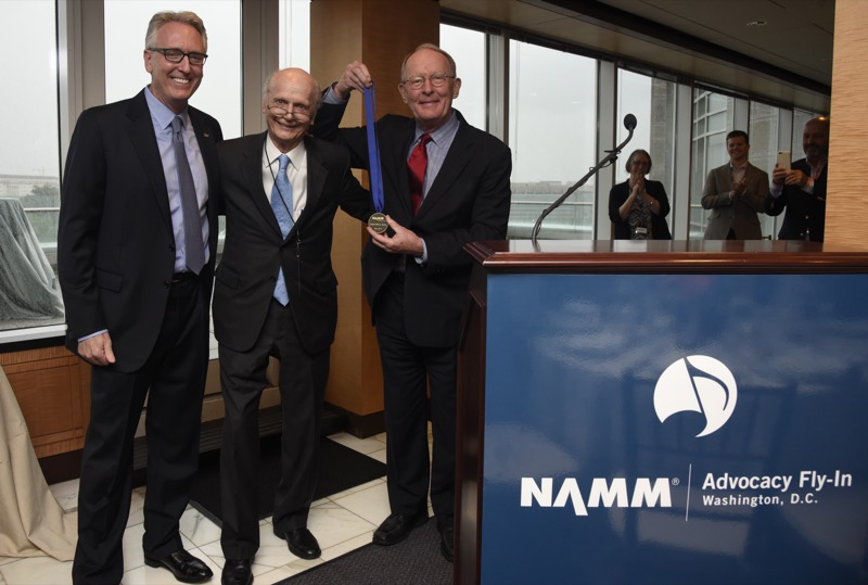 Richard Wilson Riley and NAMM President Joe Lamond presents the SupportMusic Champion Award to Senator Lamar Alexander (R-TENN) during a reception at Nelson Mullins on May 23, 2016 in Washington DC. (Photo by Kris Connor/Getty Images for NAMM)