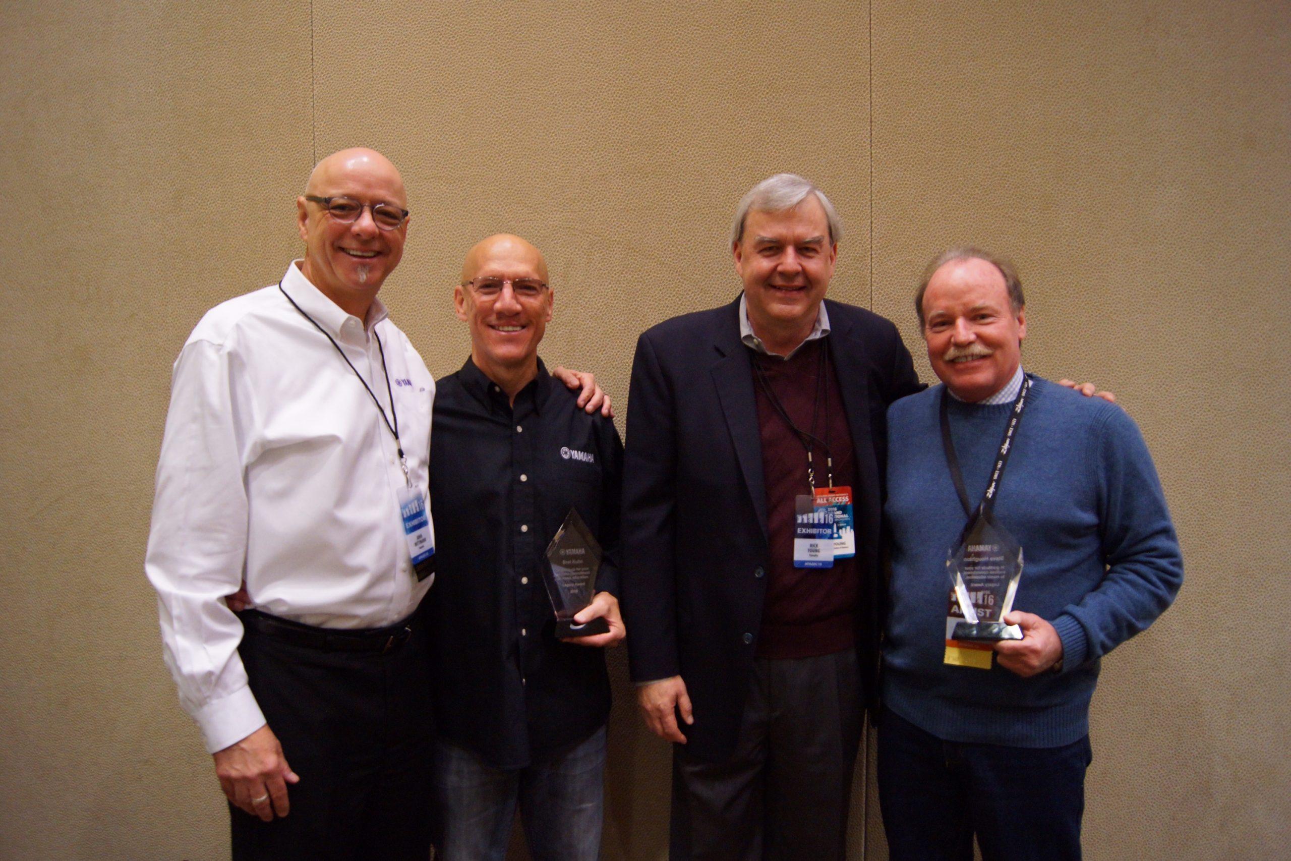 From left: John Wittmann, director, Artist Relations and Education, Yamaha; Legacy in Education Award winner Bret Kuhn; Rick Young, SVP, Yamaha; Legacy in Education Award winner Steve Houghton.