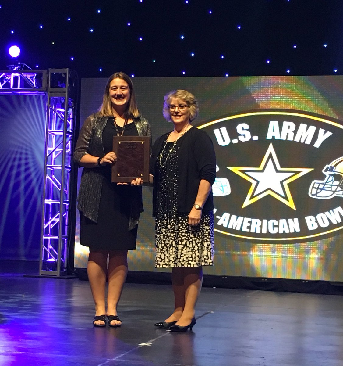 East Rowan High School Director of Bands Emily McNeil receives the 2017 NAfME Band Director of the Year Award from NAfME President Denese Odegaard.